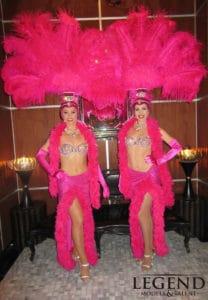 pink showgirls pose for photos at bellagio hotel las vegas for a corporate event