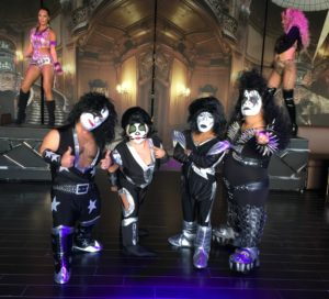 little people with kiss makeup pose for photos at a corporate event in las vegas