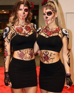 models wear day of the dead face paint for SEMA aito show in las vegas