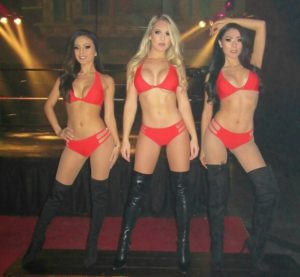 sexy gogo dancers in red bikinis for a Salient Arms International party in Las Vegas 2018