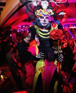 day of the dead party stilt walkers in las vegas