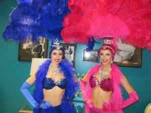 blue and pink showgirls pose for photos at the world market center in las vegas