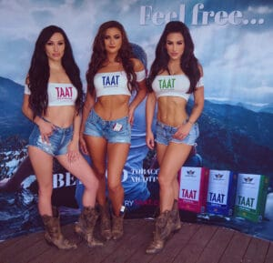 brunette promotional models in daisy dukes and cowboy boots for TAAT cigarettes in Las Vegas